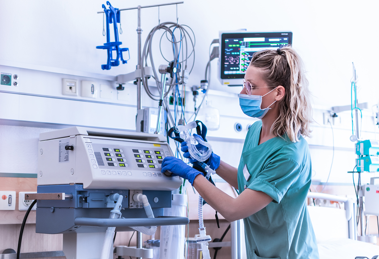 Nurse checking on a capnography ventilator