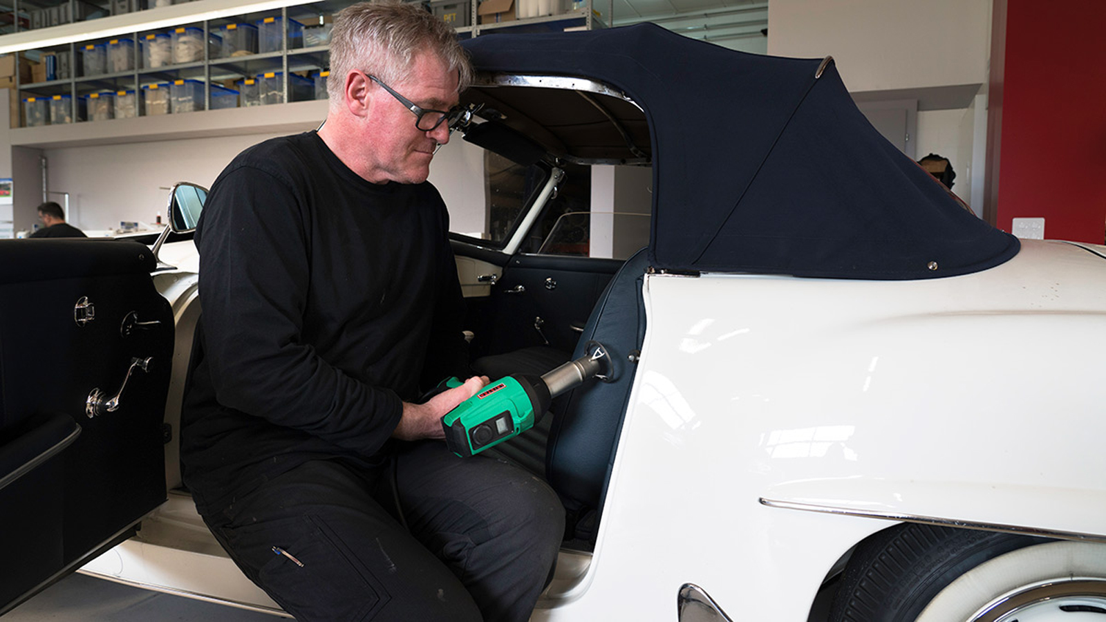 Leo Schuler smoothing a leather seat with a GHIBLI heat gun and protection nozzle