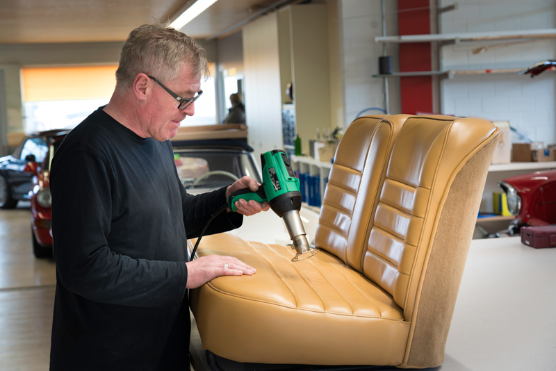 Leo Schuler smoothing a leather seat using a GHIBLI hot air tool and protection nozzle
