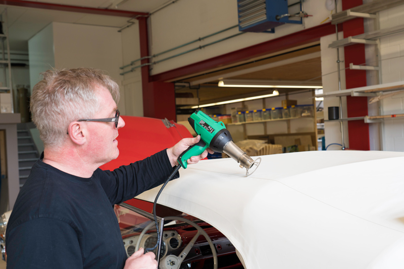 Leo Schuler smoothing a convertible top with the GHIBLI hot air tool and protection nozzle