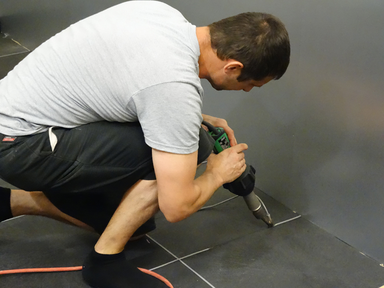 Installer from Horequip welds the cove with a TRIAC ST